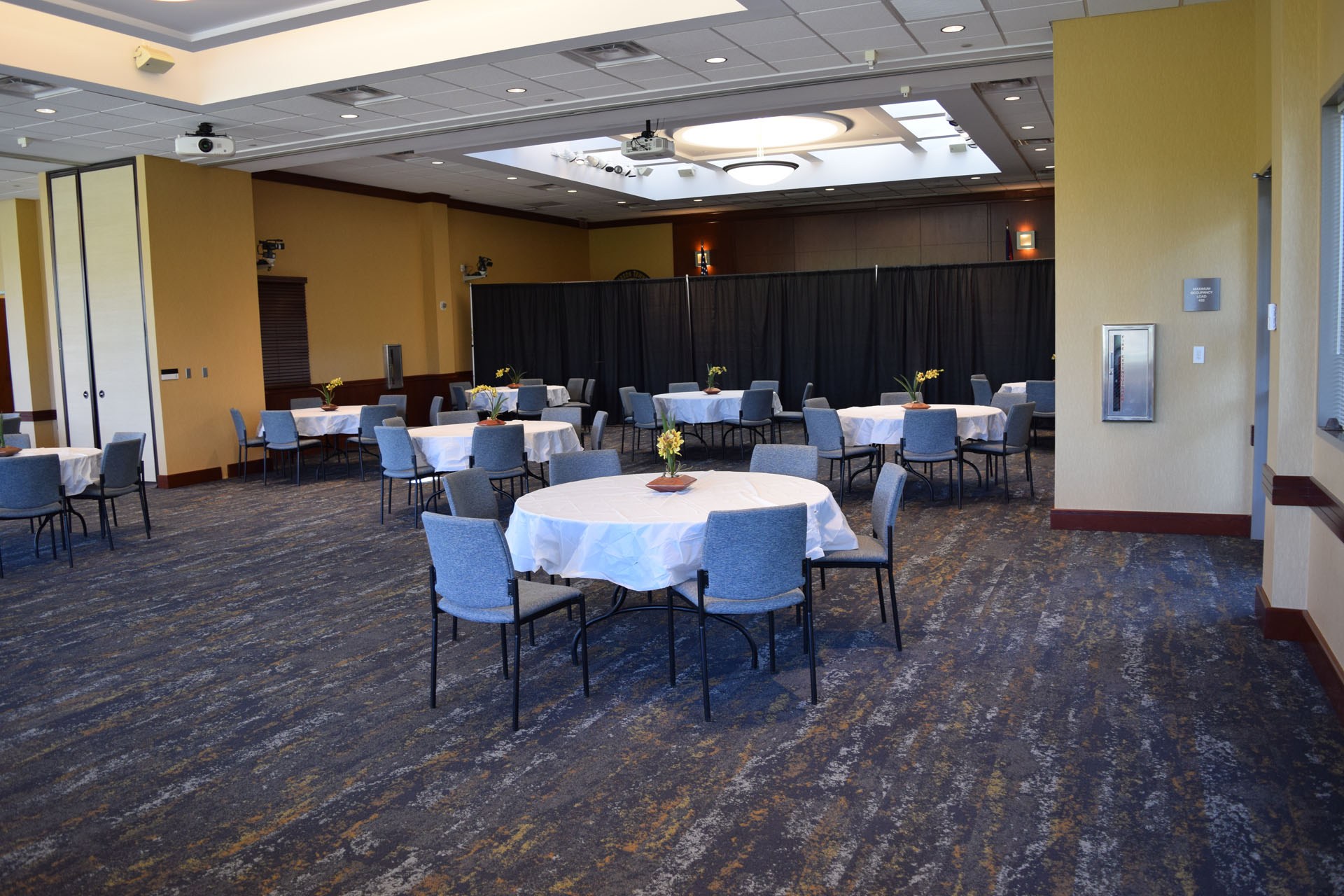 Chairs and Tables setup in the Anderson Center Community Meeting Room