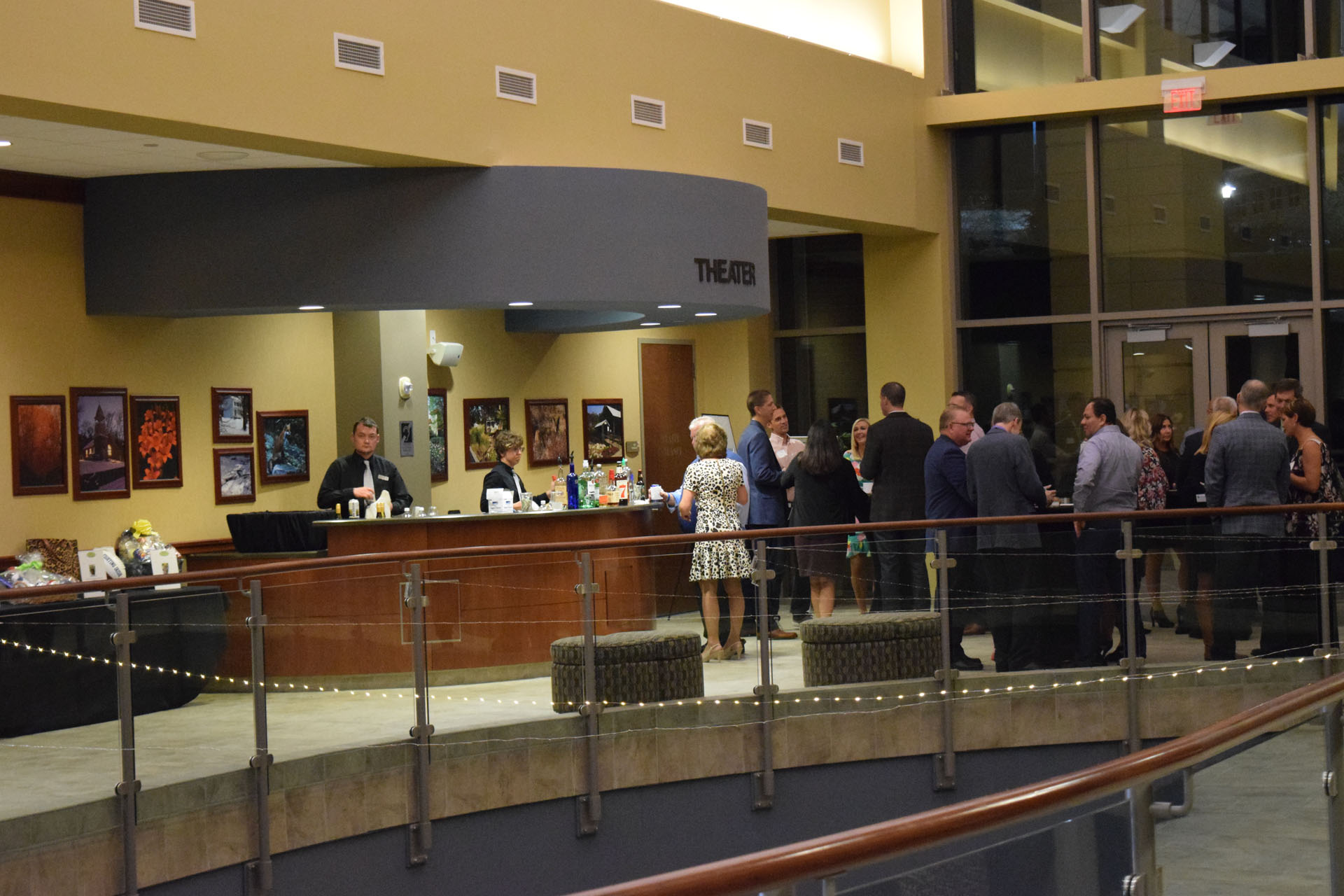 Group of People gathered at the Upper Atrium Front Desk at Anderson Center